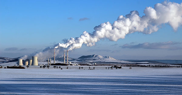 snowy landscape with steaming coal power plant